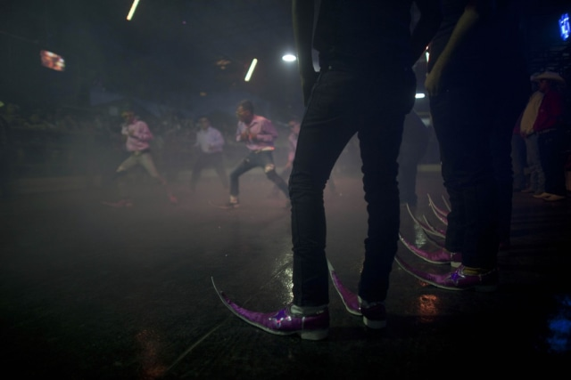 Image: The 'Parranderos' dance crew at the Mesquit Rodeo nightclub