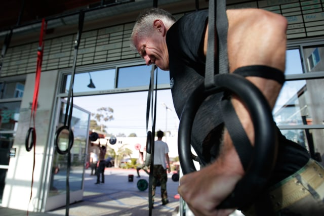 Image: Joe Stumpf works out with rings during a workout designed to mirror a US Navy SEAL training at the SEALFIT exercise center in Encinitas, Calif.