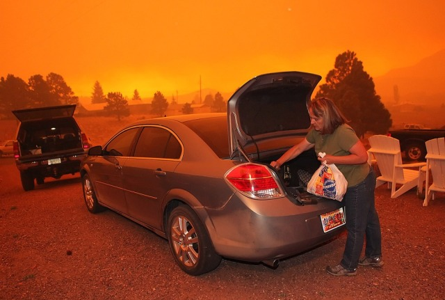 Image: Orange sky as woman evacuates