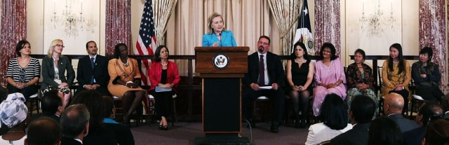 Image: Hillary Clinton discusses 2011 Trafficking in Persons report