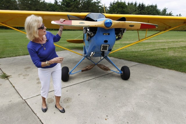Image: Myrtle Rose checks out her 1941 Piper J-3 Cub