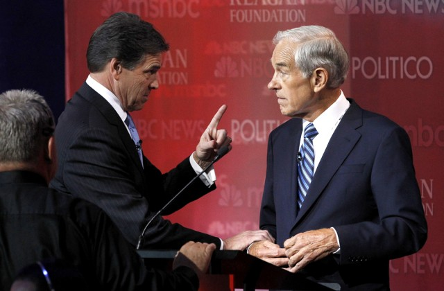 Image: Texas Governor Rick Perry talks with Rep. Ron Paul, during a commercial break at the Reagan Centennial GOP presidential primary debate at the Ronald Reagan Presidential Library in Simi Valley, Calif., on Wednesday.
