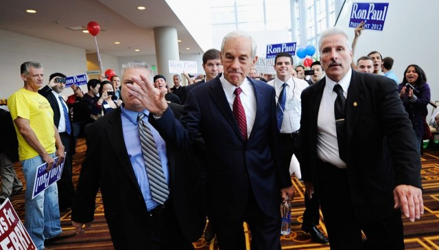 Image: Republican presidential candidate Rep. Ron Paul, R-Texas, is escorted to a ballroom Saturday to speak to supporters during the California Republican Party Convention in Los Angeles