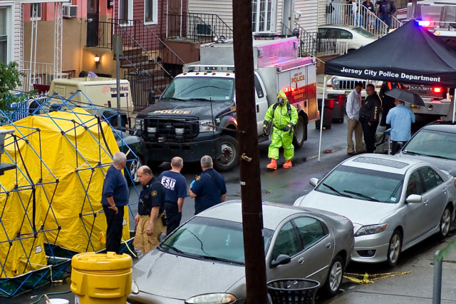 Image: Police in Jersey City, N.J., investigate the discovery of a body in a cement-filled, 55-gallon drum