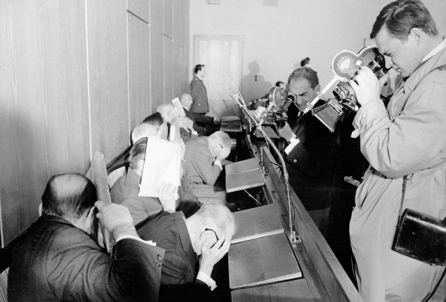 Accused former Nazi functionaries of the Treblinka death camp try to hide their faces at the beginning of the Treblinka trial in Dusseldorf, western Germany, Oct. 12, 1964.