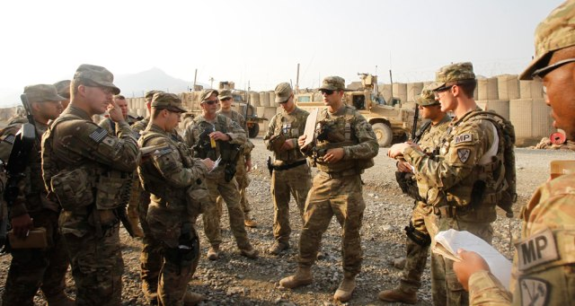 "Image: U.S. soldier SSG Brandon Shaffer from 127th Military Police Task Force ""Cacti"" conducts platoon briefing before going for a mission in Combat Outpost Penich"