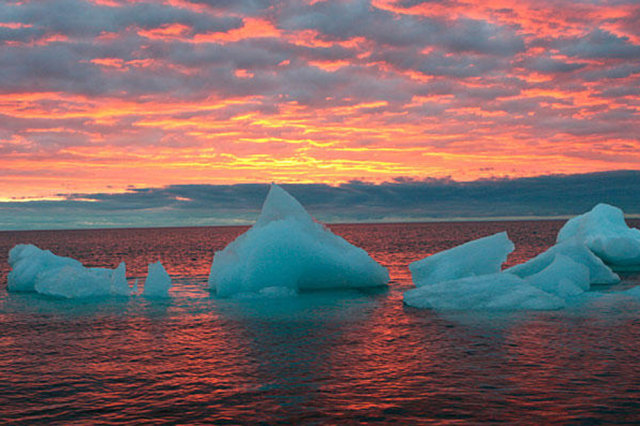 Image: Ice chunks float in the Arctic Ocean as the sun sets near Barrow, Alaska.
