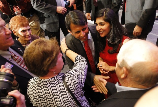 Image: Louisiana Governor Bobby Jindal and his wife, Supriya, greet supporters Saturday during his re-election victory party at the Renaissance Hotel in Baton Rouge