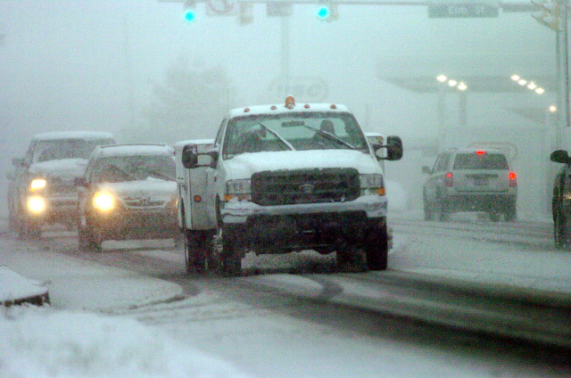 Image: Vehicles travel slowly in near white out conditions along State Route 309 in Mountaintop, Pa.