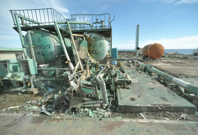 Image: Crushed tanks at the ocean-facing side of the crippled Fukushima Daiichi nuclear power plant in Fukushima