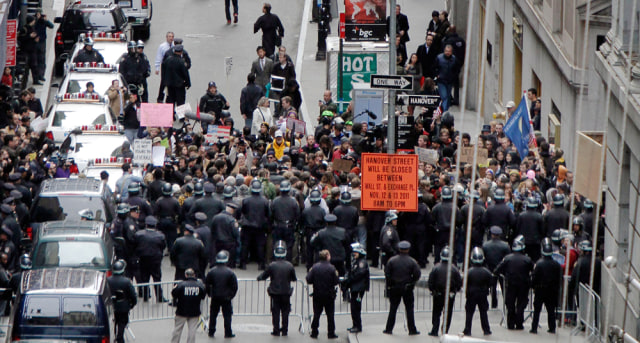 Image: New York City Police officers prevent protestors from entering Wall Street from the east on Thursday.