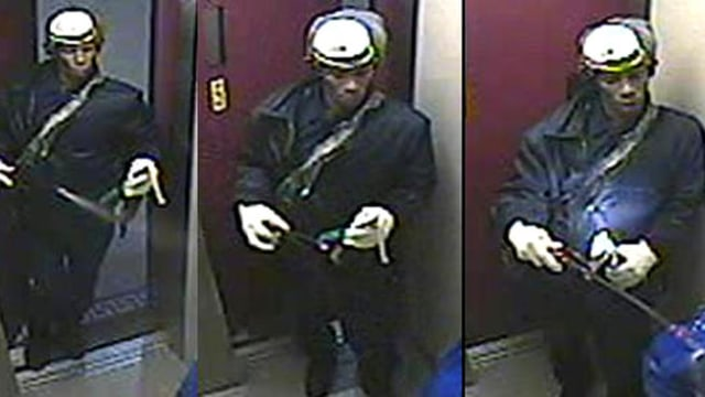Image: Suspect in elevator attack seen on surveillance video spraying a woman before setting her ablaze
