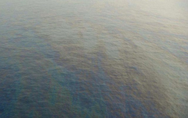 Image; A picture provided by Shell shows an oil slick following spill at the company's Bonga offshore facility, which is located 75 miles off the Nigerian coast