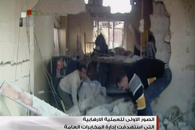 Image: Syrian TV image grab of the site of a bomb attack
