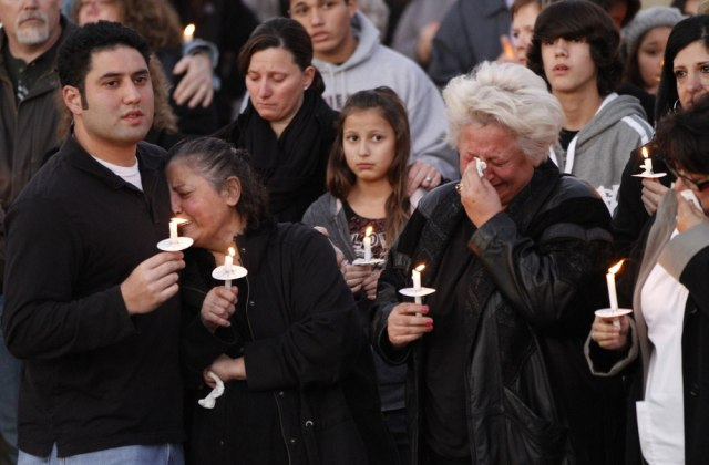 Image: Relatives attend a candlelight vigil at Parr Park in Grapevine, Texas
