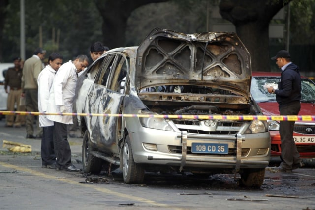Image: Indian officials examine a vehicle belonging to the Israeli Embassy after an explosion in New Delhi.