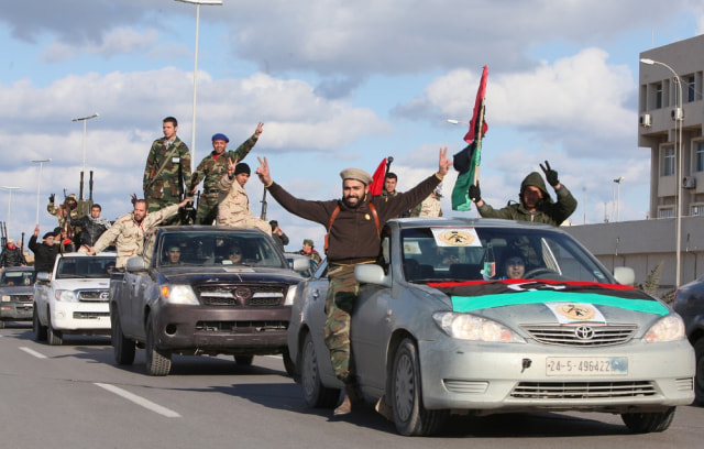 Image: Libyan militias from towns throughout the country's west parade through Tripoli.