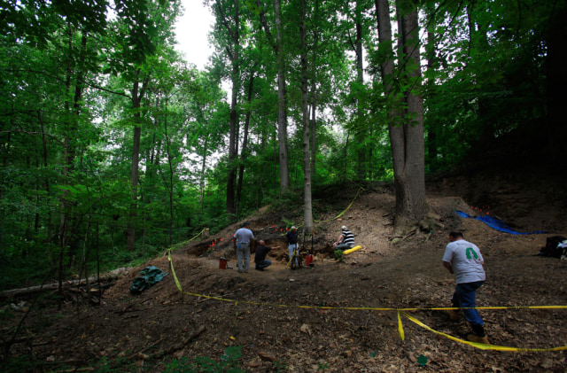 Researchers work at the site believed to be a mass grave for immigrant Irish railroad workers in Malvern, Pa.