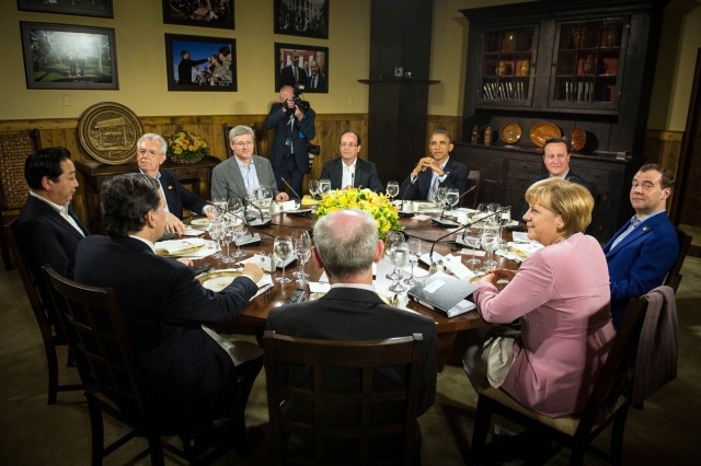 Image: President Barack Obama speaks with other G8 leaders during a Friday dinner at Laurel Lodge in Camp David, Md., during the 2012 G8 Summit.