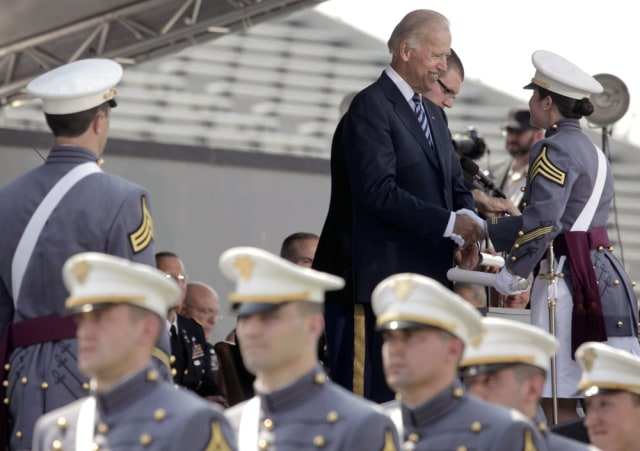 Image: Biden gives cadet her diploma