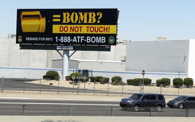 Image: Billboard warning of flashlight bombs