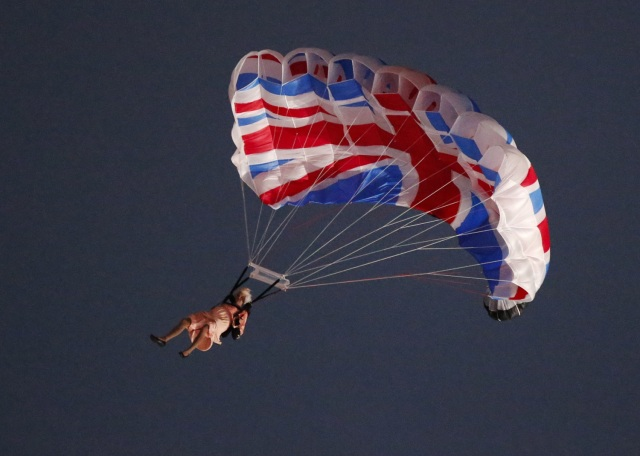 Image: A performer playing the role of Britain's Queen Elizabeth parachutes from a helicopter during the opening ceremony of the London 2012 Olympic Games
