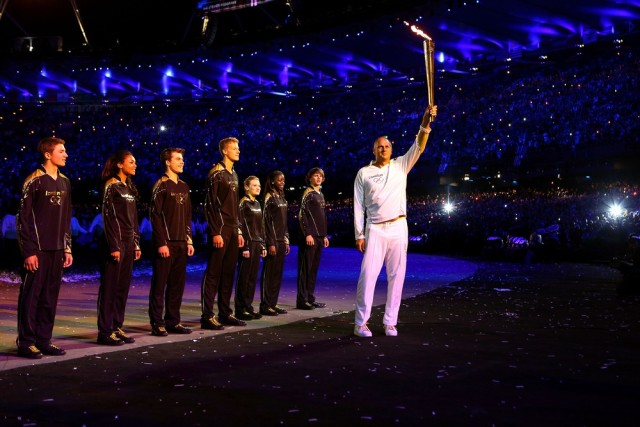 Image: Sir Steve Redgrave and seven young athletes during London 2012 Opening Ceremony