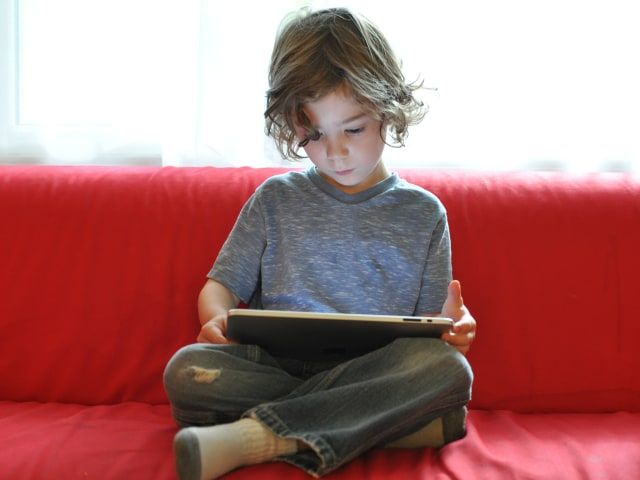 Image: Child reading on iPad