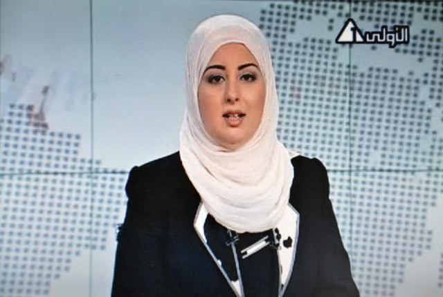 Image: An image grab taken from Egyptian state TV shows Egyptian anchorwoman Fatma Nabil wearing an Islamic headscarf
