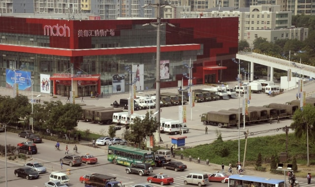 Image: Paramilitary police vehicles park outside a shopping mall near a Foxconn factory in  Taiyuan, China