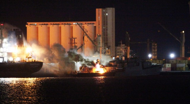 Image: Blazing boat after NATO targets Tripoli's port