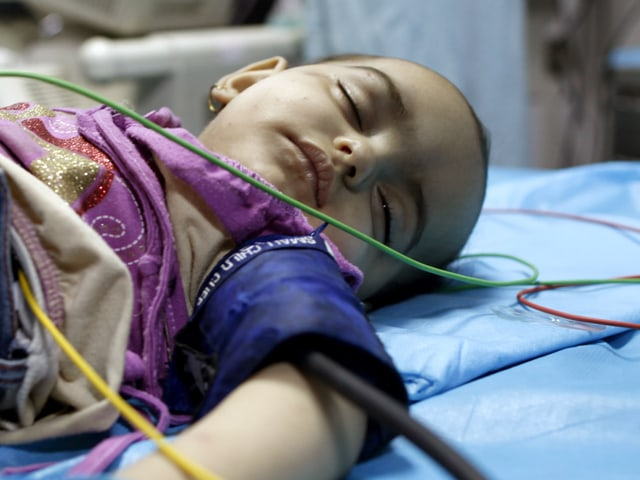 Image: Seven-month-old girl at a hospital in Tripoli