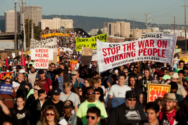 Image: Demonstrators converge on the Port of Oakland, Calif., during a general strike called by the Occupy Oakland movement