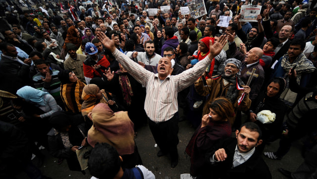 Image: Egyptian protesters chant slogans during a demonstration Friday in Cairo's Tahrir Square.
