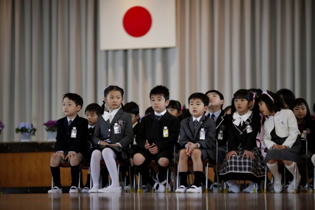 Image: Children attend a ceremony on their first day of school at Shimizu elementary school in Fukushima.