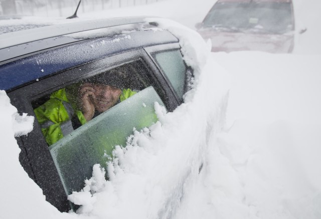 Image: Man inside car stuck in snow