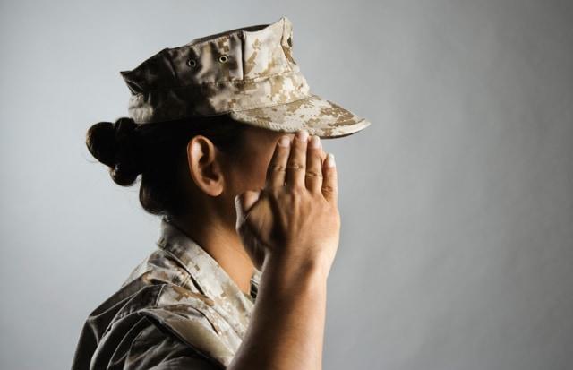 Image: Profile of a female United States Marine saluting, veteran