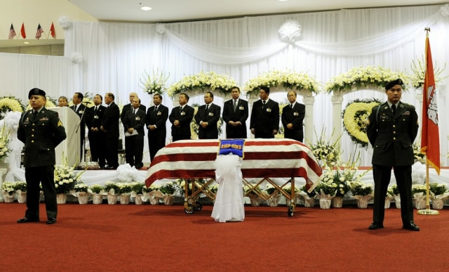 Image: Hmong war veterans and community members with Vang Pao's casket