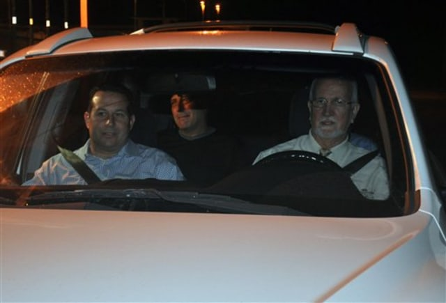 Image: U.S. businessman Gary Giordano, center, is pictured shortly after being freed from police custody Monday as he is driven away from a detention facility in Aruba.
