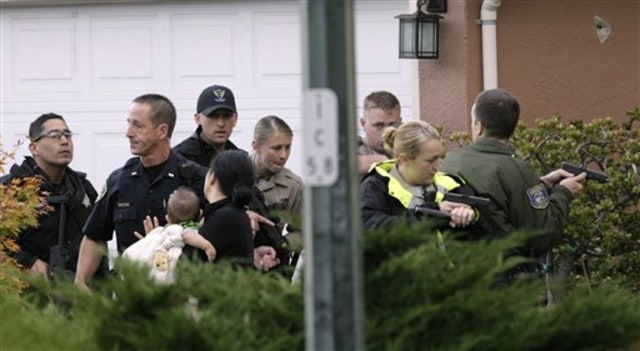 Image: Police escort woman, baby from home