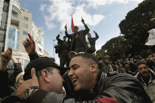Image: Police celebrate with protesters in Tunisia