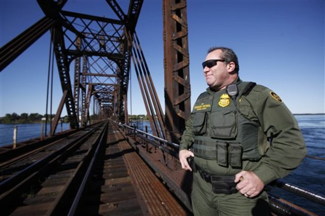 Image: Senior Border Patrol Agent Sheldon Cooper monitors the International Railroad Bridge in Buffalo, N.Y.