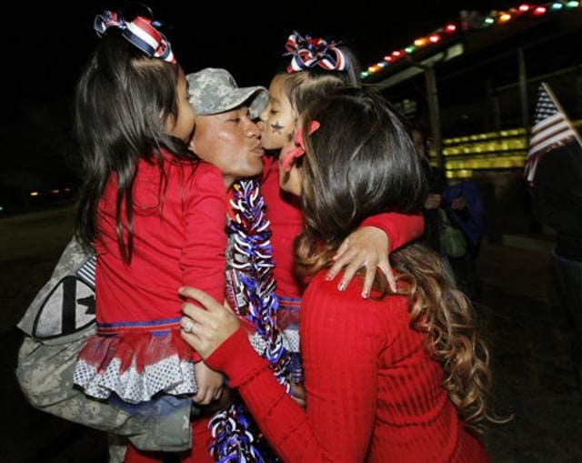 Image: Staff Sgt. Elama Palemene with his wife and children