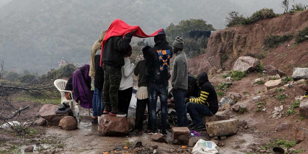 Migrants kept in a Greek field for COVID-19 quarantine