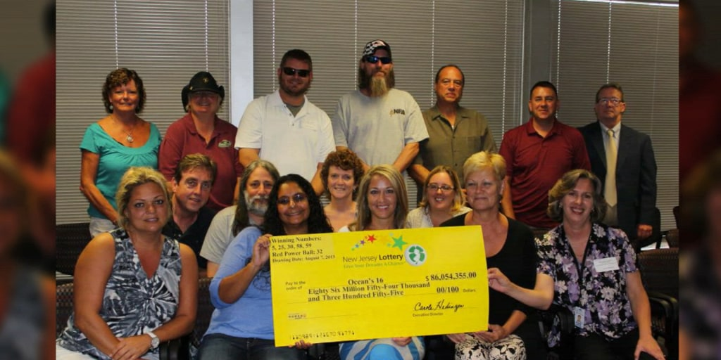 NJ lotto winners collect their payout
