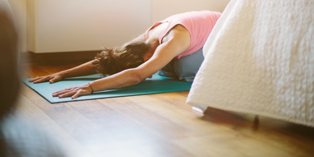 6 Yoga Poses That Will Help You Fall Sleep Faster