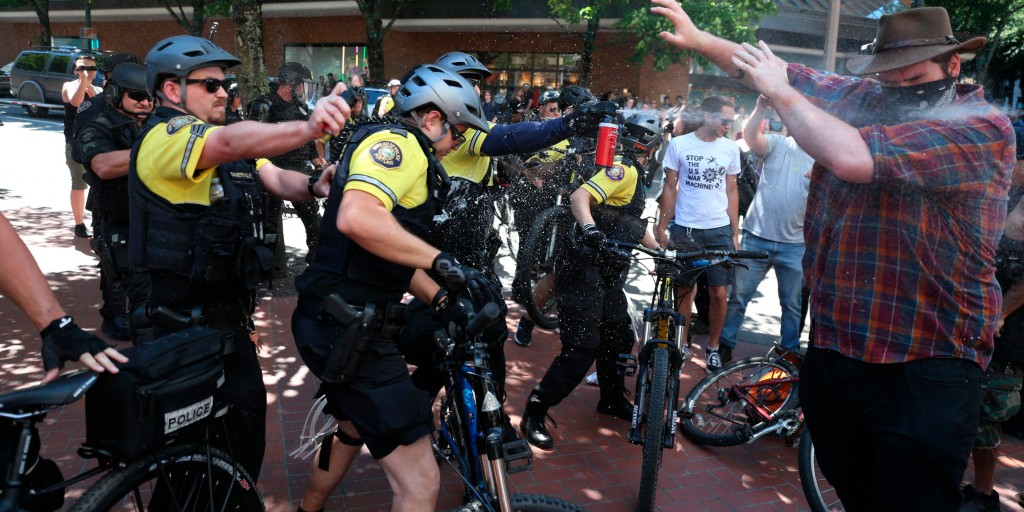 Demonstrators clash in Portland, Oregon, police warn about