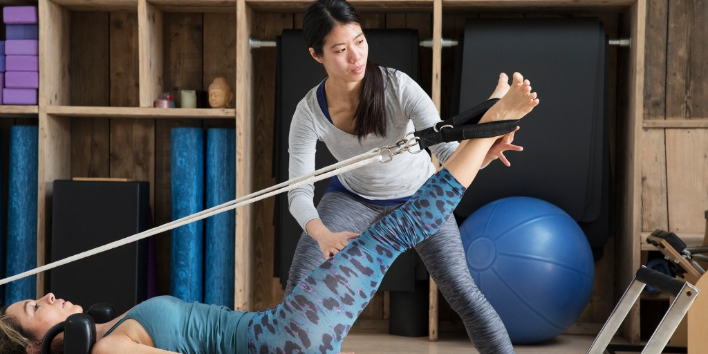 Reformer Pilates What It Is Who It S Best For And How To Do Some Moves Without The Reformer