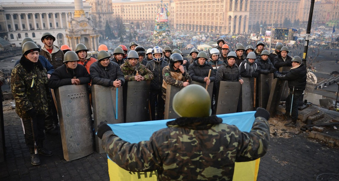 Image: Anti-government protesters man the front line barricades following yesterday's clashes with police in Independence Square, Kiev.