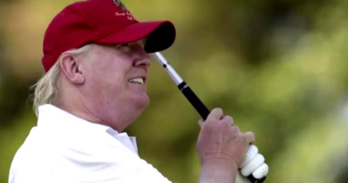 Photo of Trump wearing a MAGA hat while golfing.